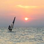 Windsurfer silhouette against sunset background — Stock Photo #45402115