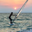 Windsurfer silhouette against sunset background — Stock Photo #45402117