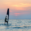 Windsurfer silhouette against sunset background — Stock Photo #45402131