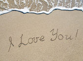 "Words ""I love you"" outline on wet sand with wave brilliance — Stock Photo"
