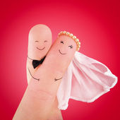 Newlyweds painted at fingers — Stock Photo