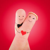 Loving couple painted at fingers against red — Stock Photo