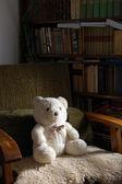 Teddy bear on armchair — Stok fotoğraf