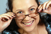Portrait about smiling woman in glasses — Stock Photo