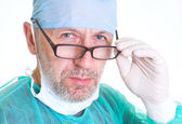 The surgeon took off his mask after of surgery — Stock Photo
