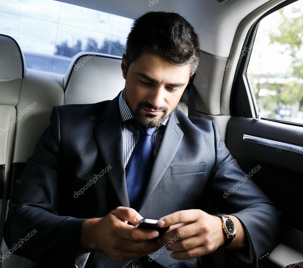 businessman in the car stock photo shumovdenis 41613605. Black Bedroom Furniture Sets. Home Design Ideas
