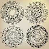 Ethnic mandalas drawn by hand — Stock Vector