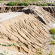 Eroded cut bank of small river — Stock Photo