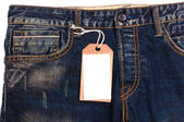 Blue jeans detail blank tag paper jeans label — Stock Photo