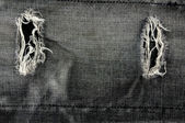 Detail of torn Black denim, front view jean — Stock Photo