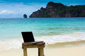 Computer notebook on beach — Stock Photo