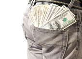 Dollar in his back pocket blue jeans. — Stock Photo