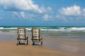 Two wooden Canvas Chairs on tropical beach — Stock Photo