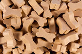 Backgrounds of bone shaped dog treats — Stock Photo