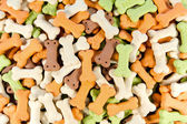 Backgrounds of color full bone shaped dog treats — Stock Photo