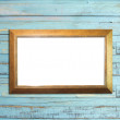 Gold Vintage picture frame on blue wood background — Stock Photo
