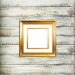 Gold Vintage picture frame on old wood background — Stock Photo