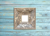 SilveVintage picture frame on blue wood background — Stock Photo