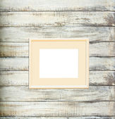 Vintage picture frame on old wood background — Stock Photo