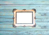 Silver Vintage picture frame on blue wood background — Stock Photo