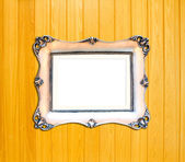 Silver Vintage picture frame on wood background — Stock Photo