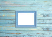 Gray Vintage picture frame on blue wood background — Stock Photo
