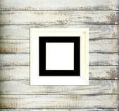 White Vintage picture frame on old wood background — Stock Photo