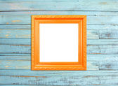 Orange Vintage picture frame on blue wood background — Stock Photo