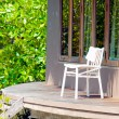 One white wooden canvas chair on private terrace — Stock Photo