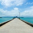 Footbridge over turquoise ocean — Stock Photo #12307881