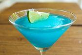 Frozen Blue Margarita Cocktail in martini glass — Stock Photo