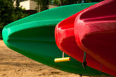 Three canoes in a row on the beach — Stock Photo