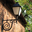 Lantern on a brick wall - Stock Photo