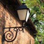 Lantern on a brick wall — Stock Photo