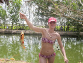 Woman with fish caught in vietnam — Stock Photo