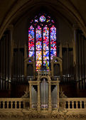 Organ and stained glass window — Stock Photo