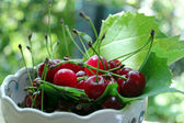 Cherry in bowl — Stock Photo
