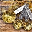 Stock Photo: Cod liver oil capsules