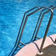 Grab bars ladder in the swimming pool — Stock Photo