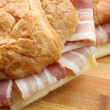 Fresh croissant with ham and cheese — Stock Photo #34646489