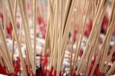 Incense sticks burning and in an altar — Stock Photo