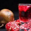 Stock Photo: Red pomegranate juice in glass