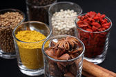 Spices and herbs in glass — Stockfoto