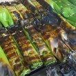 Sticky rice wrapped in banana leaves — Stock Video