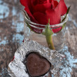 Chocolate heart and red rose — Stock Photo #39135427
