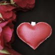 Leather heart with red roses. — Stock Photo