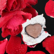 Stock Photo: Chocolate heart and red rose
