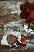 Chocolate heart and red rose — Stockfoto