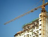 Crane and unfinished building — Stock Photo