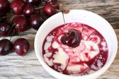 Yogurt and fresh cherries. — Stock Photo